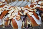 Blueberry Danish topped with icing and toasted almonds.