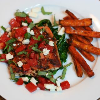 Blackened Salmon garnished with Feta, Basil, and Fresh Tomato