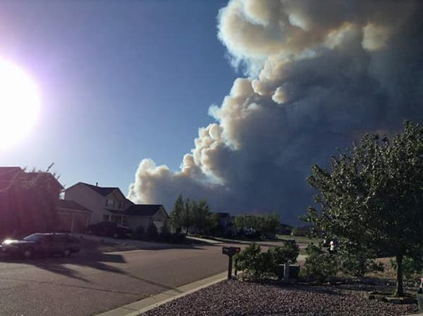 The view from a neighborhood that did not evacuate, yet were stunned by the massive plume of smoke they could see from their driveway. Photo by Rebecca Townsend, used with permission.