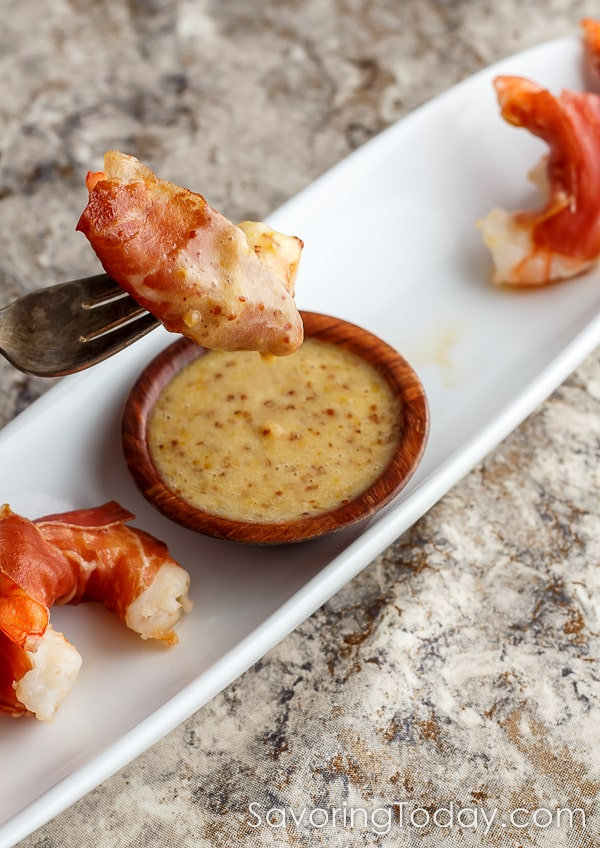 Prosciutto wrapped shrimp dipped in smoky stone ground honey mustard sauce for the win! Serve this recipe for any party or celebration.