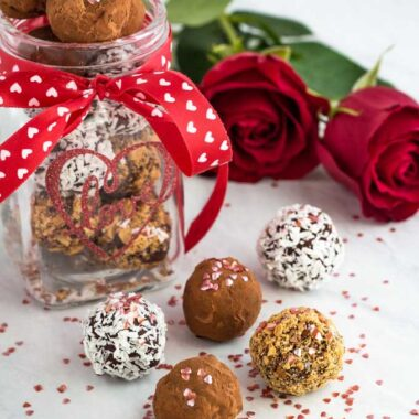 Homemade chocolate truffles prepared as a gift in a jar with roses.