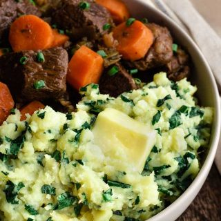 Sweet Potato mashed with kale beside beef stew.