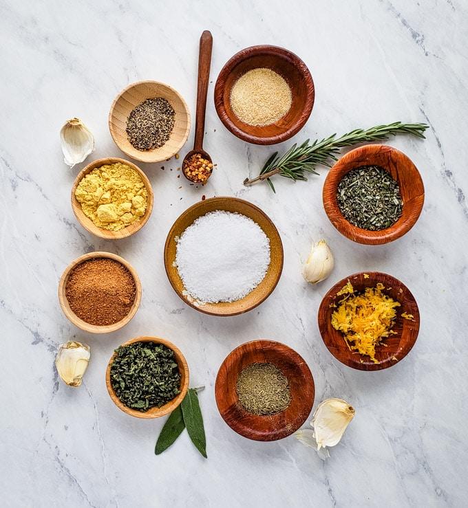 Salt, herbs, lemon zest, and spices to make dry brine rub for turkey.