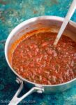 Homemade marinara sauce in a saucepan.