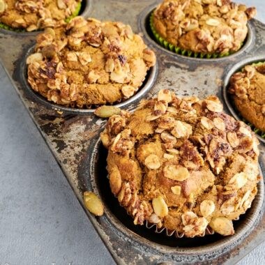 Pumpkin pie spice muffins in a tin from the oven.